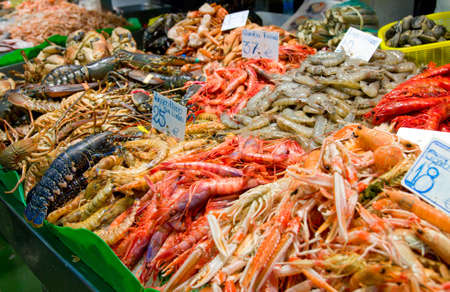 Great quantity of fresh seafood on fish market in Barcelona, Spain photo