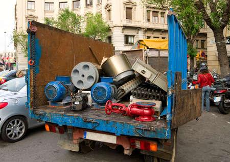 Truck with worn metal parts - heating radiators, washing machine drums etc Stock Photo - 3149992