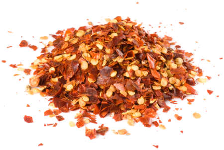 red chili pepper: Heap of crushed chili isolated on white, macro lens used