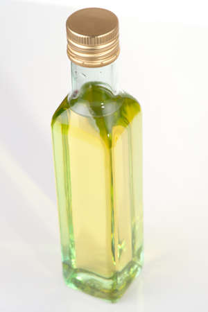 Olive oil in plain glass bottle, low contrast, limited focus photo