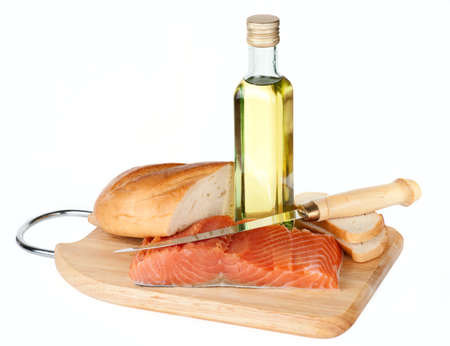 Salmon steak, olive oil and bread photo