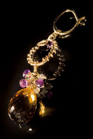 earing: Earing with semi-precious stones XXL, light painting, full frame camera macro shot