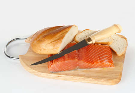 Salmon, bread and Finnish fillet knife on light background photo