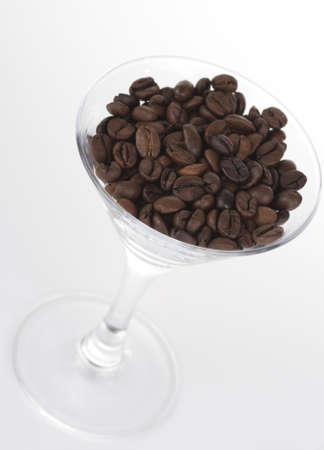 stimulation: Martini glass with coffee beans shot from above Stock Photo