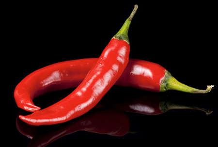 Chili peppers isolated on black background with reflection Stock Photo