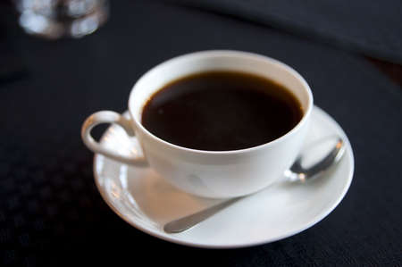 americano: Cup of americano on black table, shallow focus