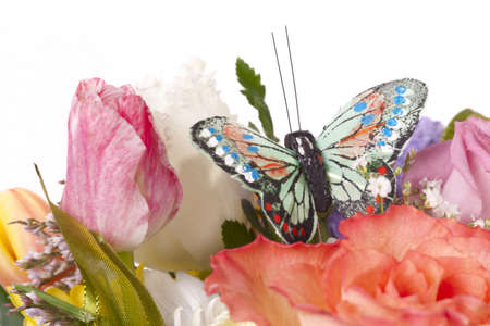 Natural flowers with artificial butterfly isolated on white Stock Photo - 4873876