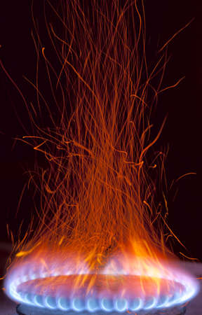 burner: Gas burns with sparks - looks like hell fire Stock Photo