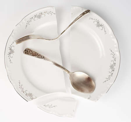 Broken plate and bent silverware - strange concept photo