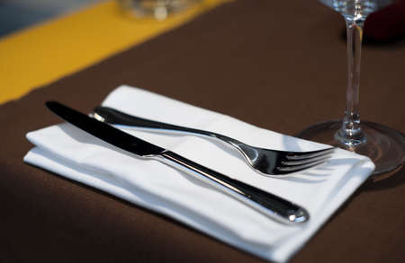 Fine dining set in restaurant, shallow dof, high contrast photo