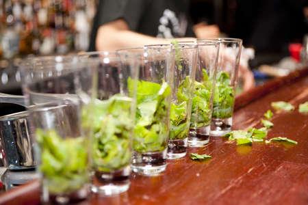 Highball glasses with mint leaves - preparing mojitas photo
