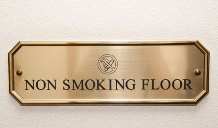 Shiny brass plate restricting smoking on hotel floor Stock Photo - 5113801