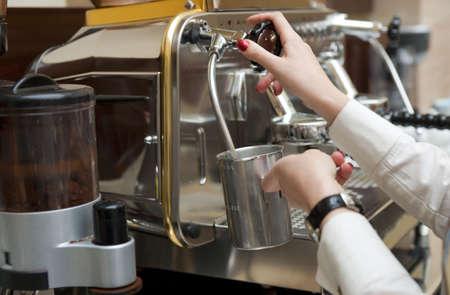 Steaming milk froth for preparing espresso latte photo