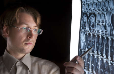 Young man pointing at MRI film photo