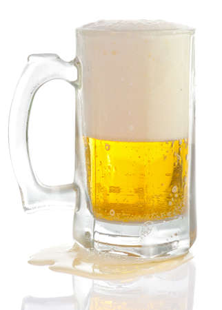 overfilled: Overfilled beer mug isolated on white