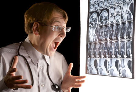 Doctor looking at the MRI scan and crying in panic photo