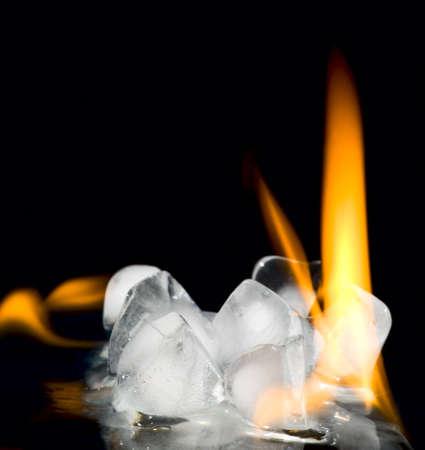 Burning stack of ice on black background photo