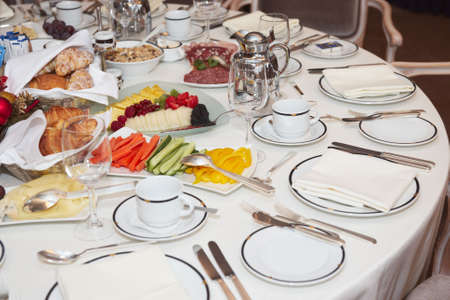 Business lunch - arranged table with snacks ready for guests photo