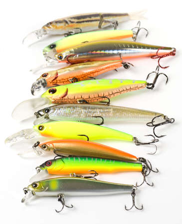 Plastic fishing lures forming a row,  shot with 1002.8 Macro prime lens Stock Photo