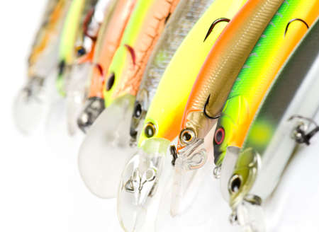 nose plugs: Plastic fishing lures forming a row,  shot with 1002.8 Macro prime lens Stock Photo