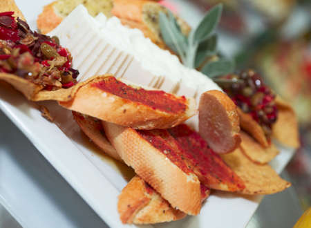 Plate with snacks on banquet table, Spanish cuisine, shallow focus  photo