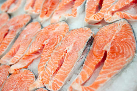 Salmon steaks on cooled market display, closeup shot photo
