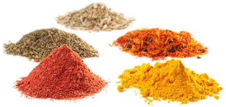 Piles of different spices on white background, selective focus   photo
