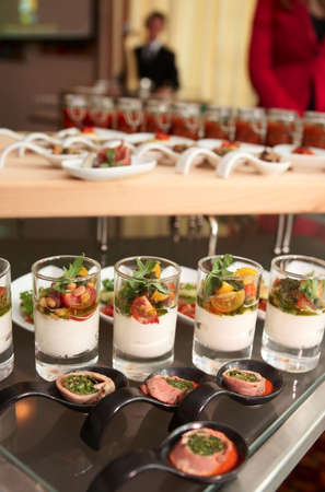 small plate: Snacks on a buffet table, blurred people in background