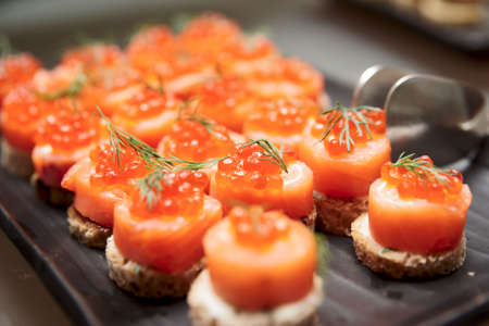 Salmon canapes, close up shot, narrow focus Stock Photo