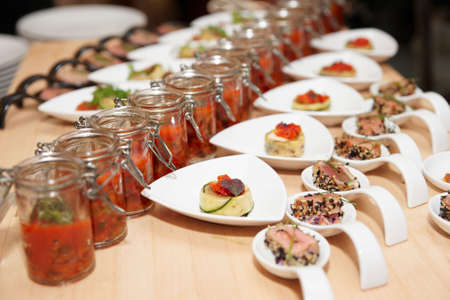 Rows of snacks on a buffet table photo