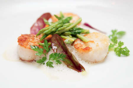 mediterranean cuisine: Grilled scallops with asparagus and molecular froth Stock Photo