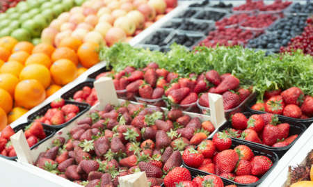 Various fresh berries on food market stall photo