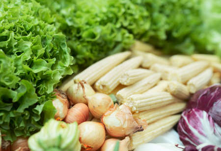 Vegetables and lettuce in supermarket, focus is on onions Stock Photo - 6910452