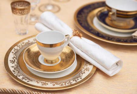 fine gold: Set of fine bone porcelain dishware