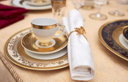 Set of fine bone porcelain dishware, shallow focus photo