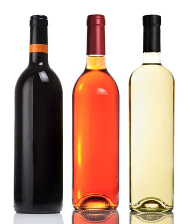Three bottles with red, pink and white wines isolated on white.
