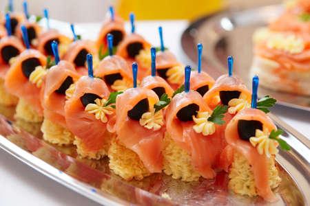 catering: Salmon canapes, close up shot, narrow focus  Stock Photo