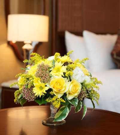 hotel service: Hotel room arranged with yellow flowers Stock Photo