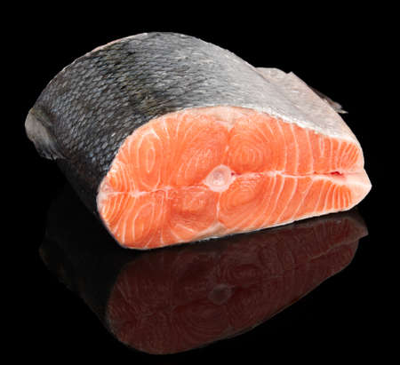 Piece of raw fresh salmon isolated on black background photo