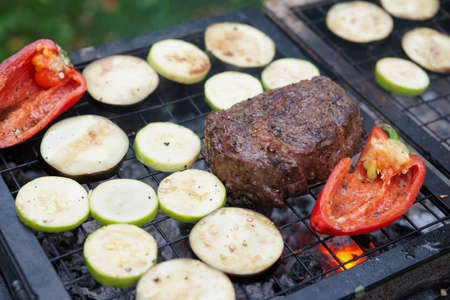 rib eye: Rib eye steak with vegetables on bbq grill Stock Photo