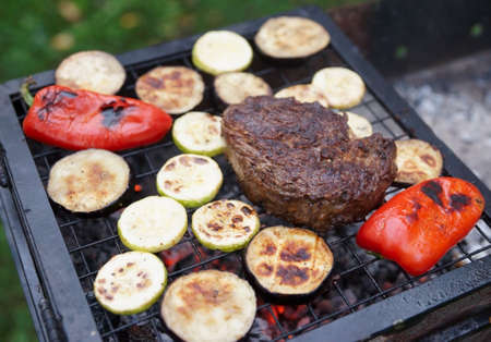 rib eye: Rib eye steak with vegetables on bbq grill Stock Photo
