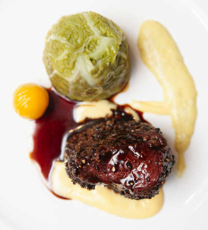 Elegant tenderloin steak with cabbage and potato mash photo