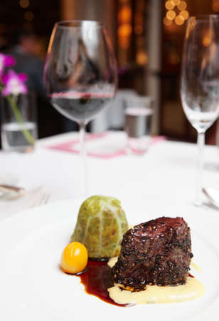 Elegant tenderloin steak on restaurant table photo