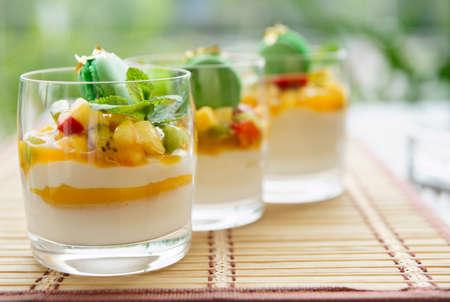 dessert table: Three fruit cocktails in a summer restaurant lounge