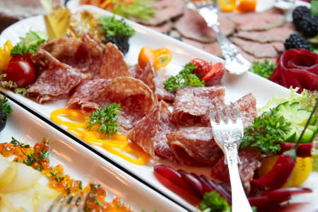Salami and and other food on restaurant buffet Stock Photo