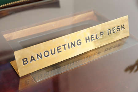 banqueting: Banqueting help desk brass plate Stock Photo