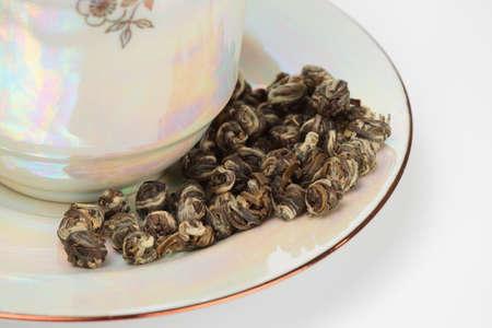 elite: Elite oolong tea in porcelain close-up
