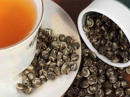 elite: Elite oolong tea in porcelain cup, close-up