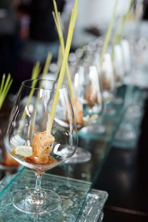 Small snacks in cognac snifters photo