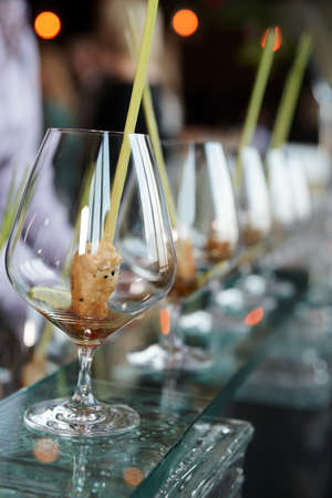 Small  snacks in cognac snifters, selective focus photo